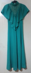 Long vintage 70s dress in green with high lace neck and ruffle over the shoulders.