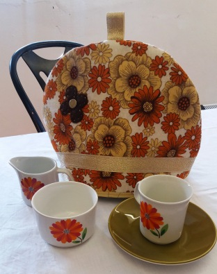 brown flower tea cozy