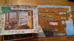 Victory wooden jigsaw puzzle half completed with box.