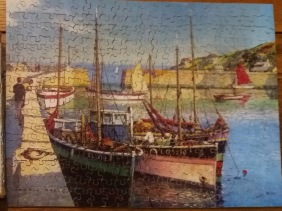 Completed wooden Victory puzzle of ships.