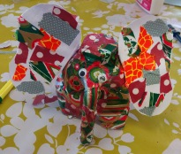 Elephant made from a plastic milk bottle and covered in paper patches made at the Tuftydawn Designs children's craft classes.