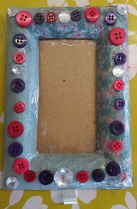 Grey and pink decoupatch picture frame with button decorations made at the Tuftydawn Designs studio.