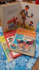 Topsy and Tim vintage books on blue flowery 60s print fabric.