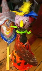 Painted model of a bird made of card, feathers and paint made at the Tuftydawn Designs studio.