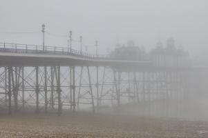 Eastbourne Pier shrouded in mist.