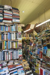 Inside Camilla's Bookshop in Eastbourne piled high with books.