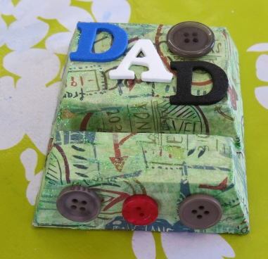 Wooden decoupaged mobile phone stand with Dad and button decorations made at the Tuftydawn Designs studio.