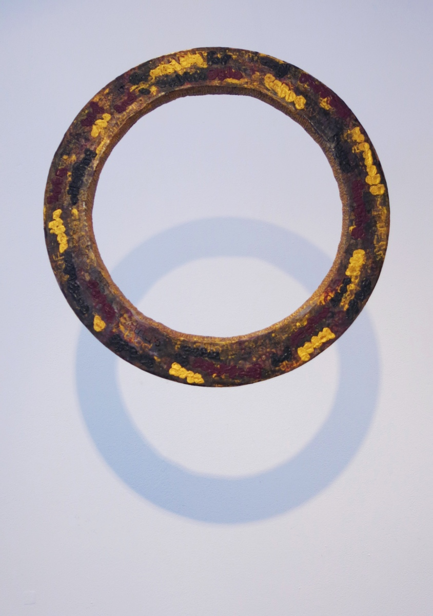 Wooden ring with wax layers and inlaid text- Portal sculpture.