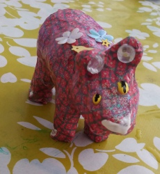 Paper mache pig covered in ik flower paper wih sparkle ears and sequins made at Tuftydawn Designs studio.