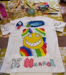 Tshirt with a painted emoji, rainbows and pandas made at the Tuftydawn Designs studio.