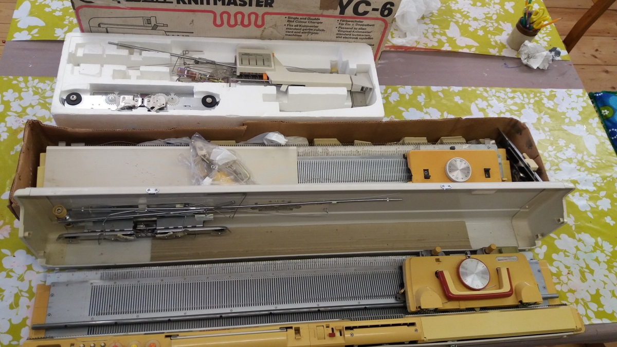 Photo of a Knitmaster Knitting machine and accessories.