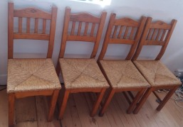 Four pine farmhouse style chairs with rush seating.