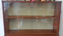 Wooden two shelf unitwith engraved glass sliding doors.