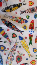 White fabric with Portuguese patterned fish motifs.