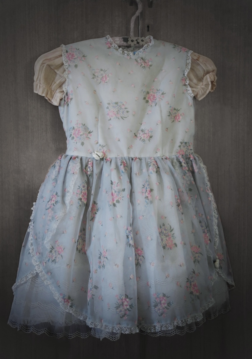 Photo of a 1940's pale blue girls party dress.