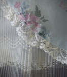 Photo of a detail of a 1940's pale blue girls party dress.