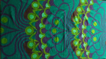 Section of vintage Heals fabric in greens