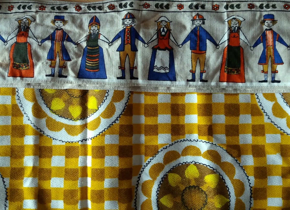 Yellow flower & gingham fabric with a band of Scandinavian people printed fabric.