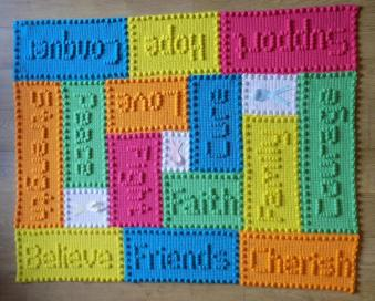coloured crochet blocks with words spelt out on them in puff stitch