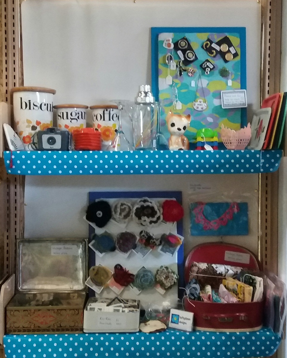 Two shelves with vintage items.