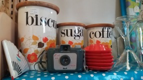 1960's camera, biscuit jar, retro egg cups.