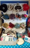 Display of hand made felt and crochet brooches.